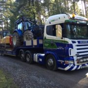 Lowloader loaded with valtra & cat