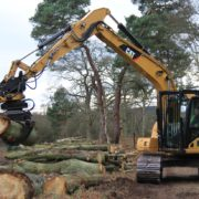 Excavator with tree grab for tree clearance