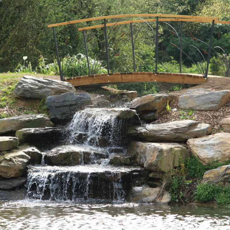 Private water feature cascade with bridge