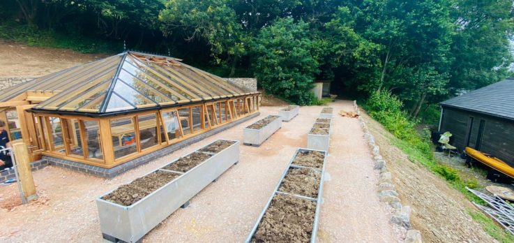 Greenhouse and planters