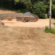 Wooden greenhouse and gabion retaining wall
